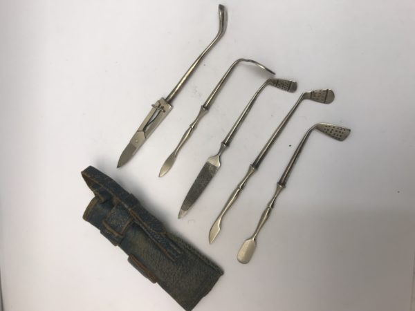 An interesting 5 piece Silver golf manicure set with original 'golf bag' case