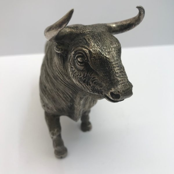 A Realistic Silver plated model of a bull,