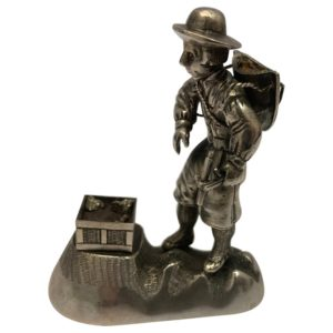 Small antique silver figural model of a prospector
